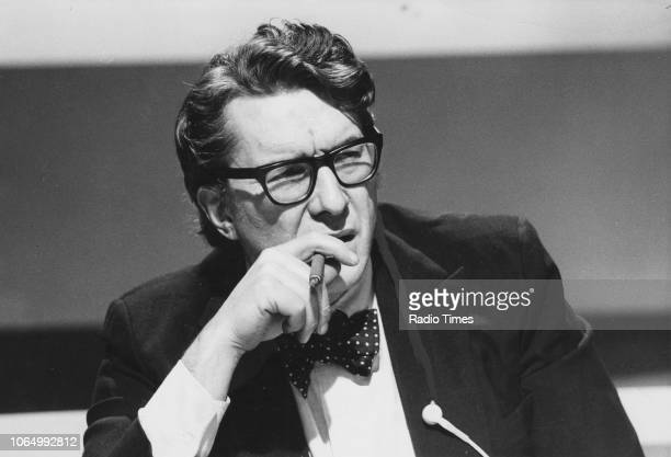 Broadcaster Robin Day smoking a cigar on the set of the General Election show 'BBC Election 74' January 6th 1974 First printed in Radio Times issue...