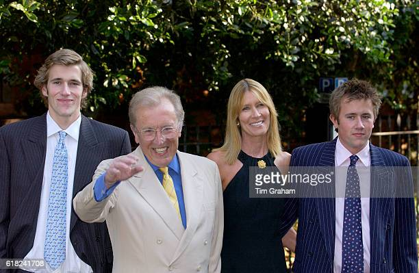 Broadcaster Sir David Frost with his wife Carina and sons Miles and Wilfred at his annual party in Chelsea