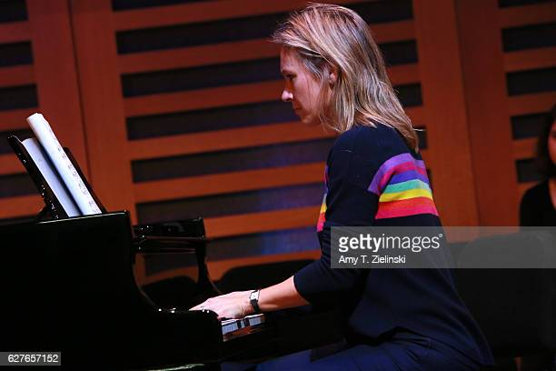 BBC 1 broadcaster Sophie Raworth rehearses at a Steinway piano before a performance of 'Word And Play Celebrity Christmas Gala' at Kings Place on...