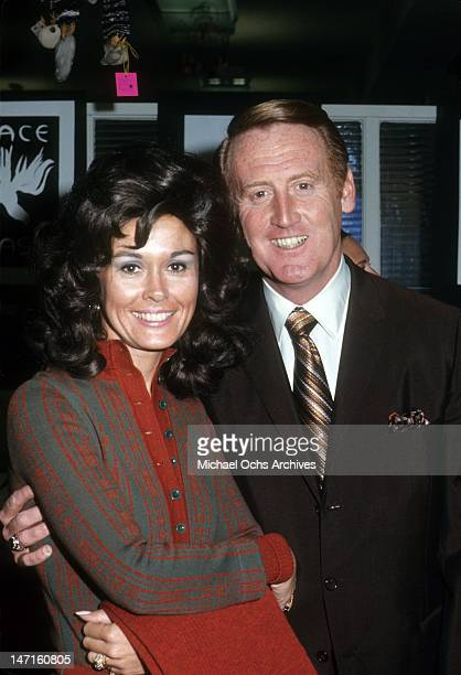 Broadcaster Vince Scully and his wife Joan Crawford poses for a portrait circa December, 1970 in Los Angeles, California.