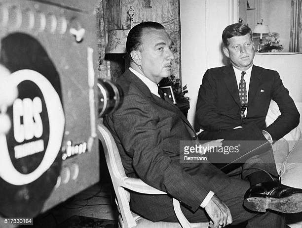 Broadcaster Walter Cronkite and presidential candidate John F. Kennedy wait for the signal to begin their television interview at Kennedy's home.