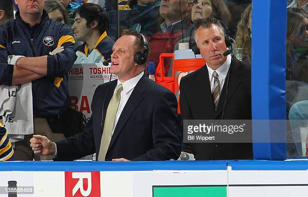 Broadcasters and former players Rob Ray and Dave Andreychuk work the game between the Buffalo Sabres and the Tampa Bay Lightning at First Niagara...