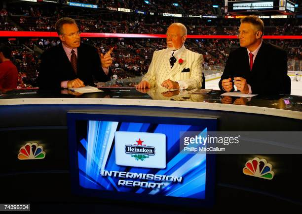 Broadcasters Bill Clement Don Cherry and Brett Hull speak during the intermission show of Game Four of the 2007 Stanley Cup finals between the...