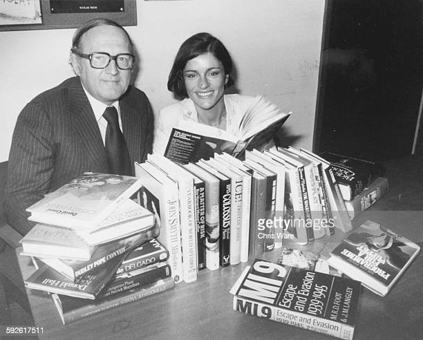 Broadcasters Diana Quick and Robert Robinson copresenters of the new BBC 2 show 'Word for Word' pictured reading books at BBC Television Centre on...