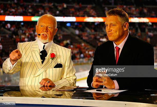 Broadcasters Don Cherry and Brett Hull speak during the intermission show of Game Four of the 2007 Stanley Cup finals between the Anaheim Ducks and...