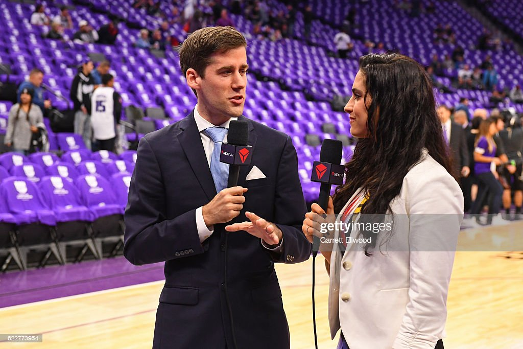 VR broadcasters, Julianne Viani and Jonathan Yardley, work on court before the San Antonio Spurs game against the Sacramento Kings on October 27, 2016 at the Golden 1 Center in Sacramento, California.