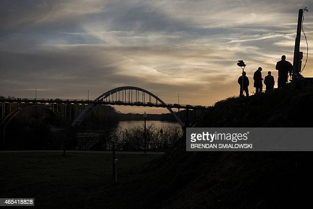 Broadcasters stand on a hill overlooking the Edmund Pettus Bridge on March 6, 2015 in Selma, Alabama. The march from Selma to Montgomery, which US...