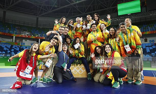 Broadcasting workers and volunteers pose for a group photo after the end of the wrestling competition at the Rio de Janeiro Olympics on Aug 21 2016