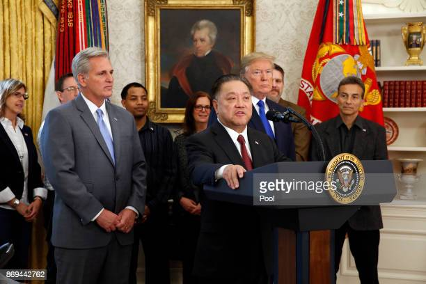 Broadcom CEO Hock Tan announces the repatriation of his company headquarters to the United States from Singapore as US President Donald Trump looks...