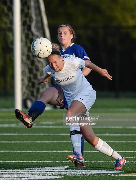Broadneck defender Erin Rose heads the ball away from Leonardtown's Lizzy Wolfe during the Maryland High School 4A East girls' soccer quarterfinal...