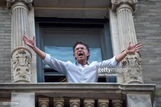 Broadway actor and singer Brian Stokes Mitchell sings from his window in honor of healthcare workers amid the coronavirus pandemic on April 28 2020...