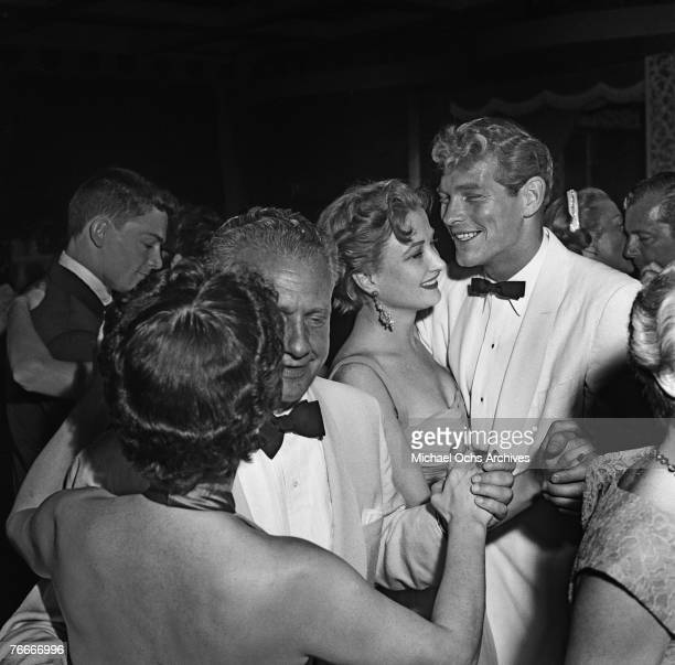 Broadway and Hollywood actress Nina Foch dances with actor Peter Graves at Ciro's nightclub a famous watering hole for the Hollywood elite along the...