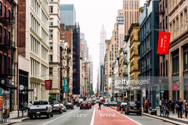 broadway and soho shopping district in new york city, usa - broadway manhattan stock pictures, royalty-free photos & images