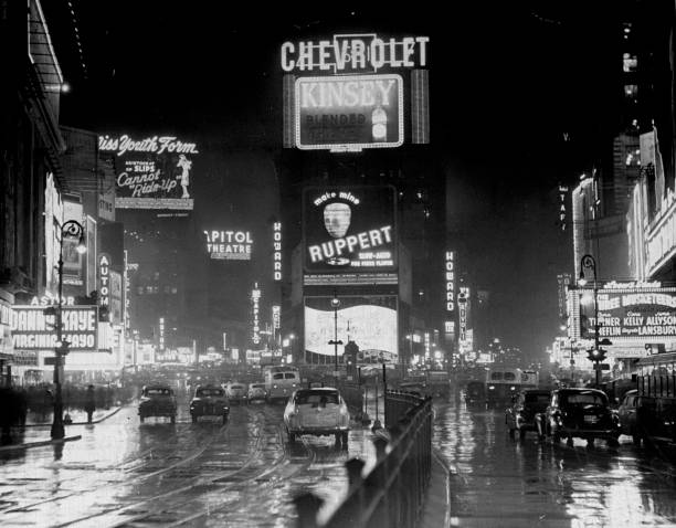 Broadway and Times Square at night during the 1950's.