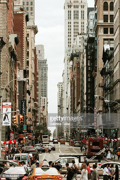 broadway avenue in soho manhattan, new york city - broadway manhattan stock photos and pictures