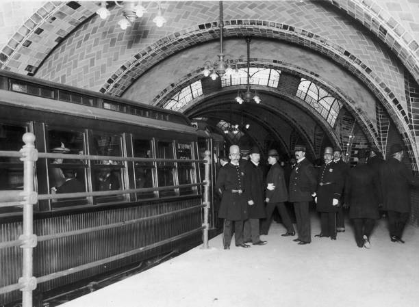 The Broadway Local subway train stops at an underground...