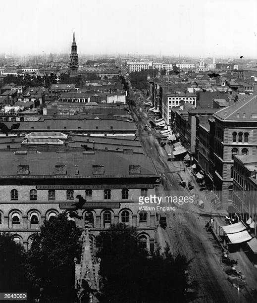 Broadway New York City looking north from Trinity Church with the spire of St Paul's Chapel in the middle distance and the Brandreth Hotel in the...
