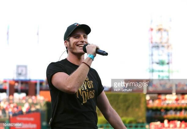 Broadway performer Sean Thompson form 'Love Never Dies' performs God Bless America during a game between the Atlanta Braves and Philadelphia Phillies...
