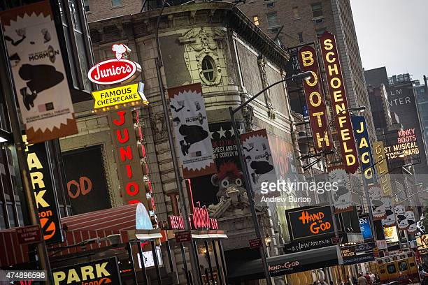 Broadway play marquees are seen near Times Square on May 27 2015 in New York City Broadway theaters drew more than 13 million attendees a new record...