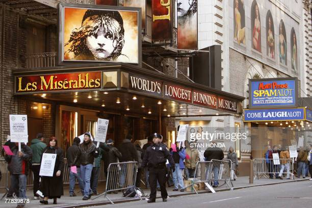 Broadway stagehands walk a picket line in front of Les Miserables at the Broadhurst Theater 10 November 2007 in New York as most theaters are shut...