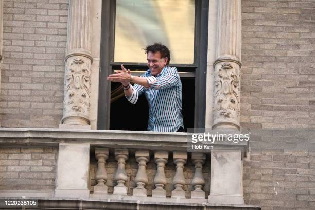 Broadway star Brian Stokes Mitchell performs for the public from his window to celebrate the medical workers combating COVID19 during the coronavirus...
