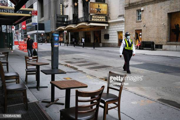 Broadway theaters stand closed along an empty street in the theater district on June 30 2020 in New York City The Broadway League a trade...