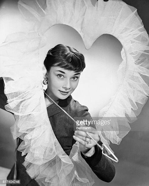 Broadway's newest sweetheart bewitching Briton Audrey Hepburn makes a lovely Valentine decoration complete with Cupidlike smile and arrow The young...