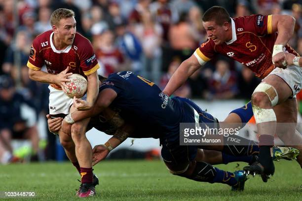 Broc Hooper of Southland in the tackle of Sione Misiloi of Otago looks to pass the ball during the round five Mitre 10 Cup match between Southland...