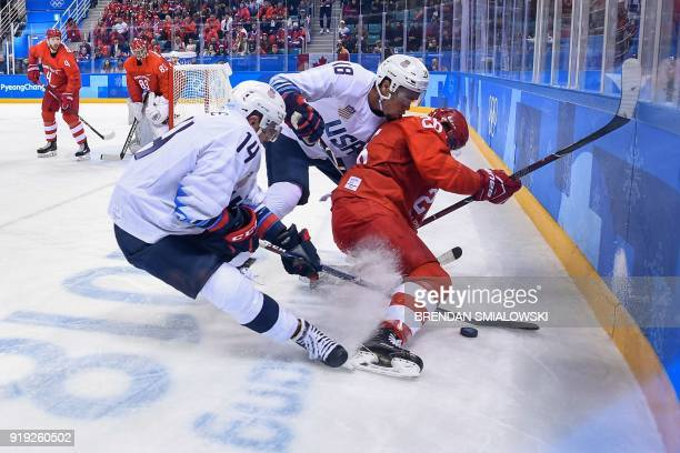 Broc Little US Jordan Greenway and Russia's Vyacheslav Voinov vie for the puck in the men's ice hockey preliminary round group B game between the...