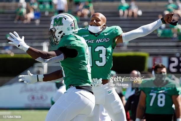 Broc Thompson of the Marshall Thundering Herd celebrates after a touchdown reception by Amir Richardson in the fourth quarter against the Eastern...