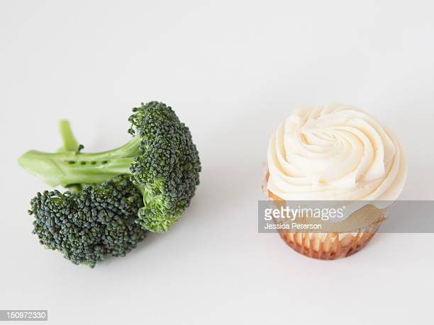 Broccoli and muffin on white background, studio shot