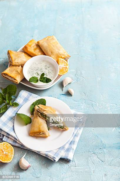 broccoli and spinach spanakopita - greek food stock pictures, royalty-free photos & images