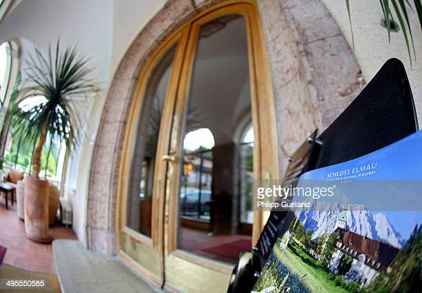 Brochure is displayed next to the entrance at Schloss Elmau, a luxury spa hotel, in the Bavarian Alps of southern Germany on June 3, 2014 in Kruen...