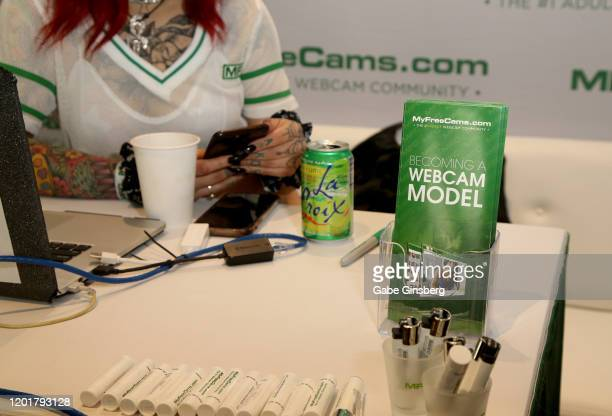 Brochures on how to become a webcam model are displayed at the MyFreeCams booth during the 2020 AVN Adult Expo at the Hard Rock Hotel Casino on...