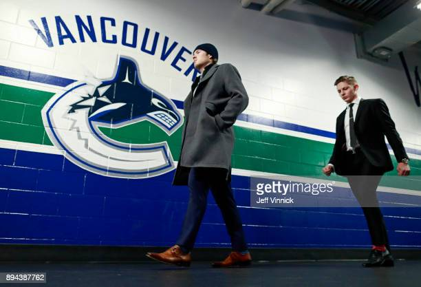 Brock Boeser and Troy Stecher of the Vancouver Canucks walks to their dressing room before their NHL game against the Calgary Flames at Rogers Arena...