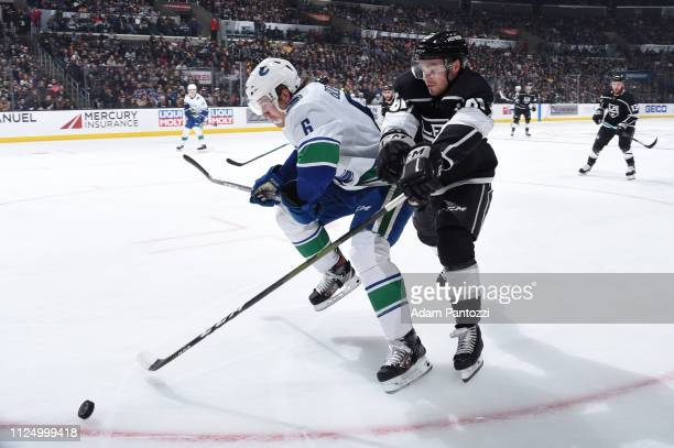 Brock Boeser of the Vancouver Canucks and Carl Hagelin of the Los Angeles Kings battle for the puck during the second period of the game at STAPLES...