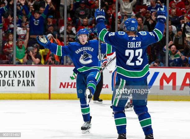 Brock Boeser of the Vancouver Canucks celebrates a goal with teammate Alexander Edler during their NHL game against the Montreal Canadiens at Rogers...