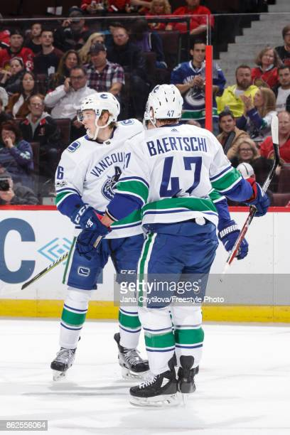 Brock Boeser of the Vancouver Canucks celebrates his first period powerplay goal against the Ottawa Senators with team mate Sven Baertschi at...