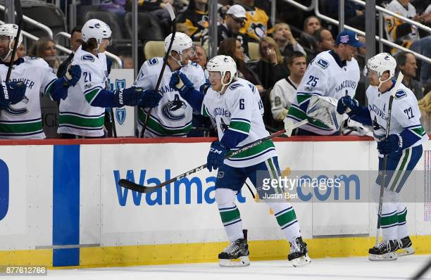 Brock Boeser of the Vancouver Canucks celebrates with teammates on the bench after scoring his second goal of the game in the second period during...