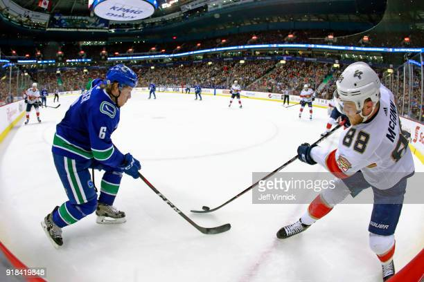 Brock Boeser of the Vancouver Canucks checks Jamie McGinn of the Florida Panthers during their NHL game at Rogers Arena February 14 2018 in Vancouver...