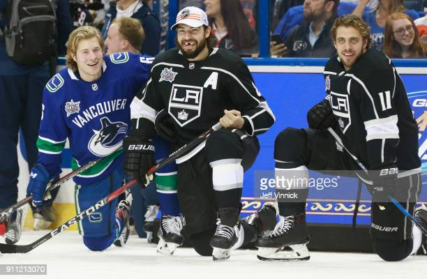 Brock Boeser of the Vancouver Canucks Drew Doughty and Anze Kopitar of the Los Angeles Kings look on during the Dunkin Donuts NHL Passing Challenge...