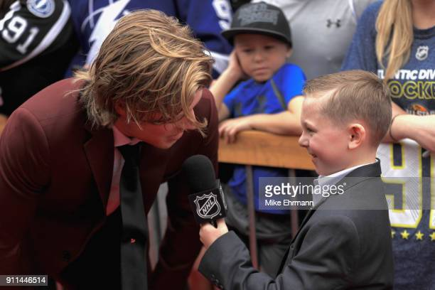 Brock Boeser of the Vancouver Canucks gets interviewed after arriving on the red carpet prior to the 2018 Honda NHL AllStar Game at Amalie Arena on...