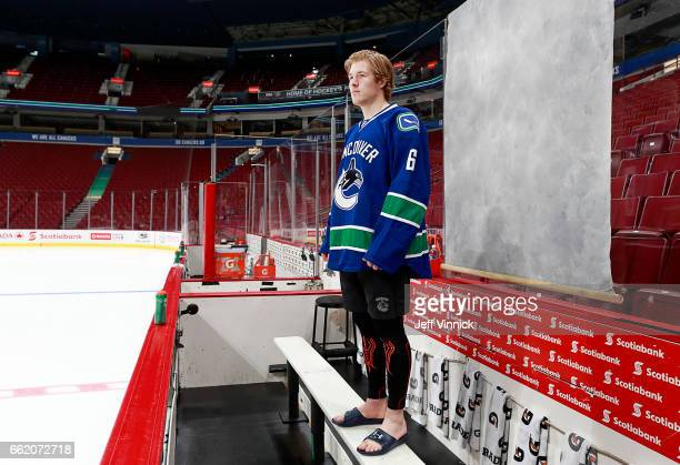 Brock Boeser of the Vancouver Canucks poses for his official NHL headshot before their NHL game against the Los Angeles Kings at Rogers Arena March...