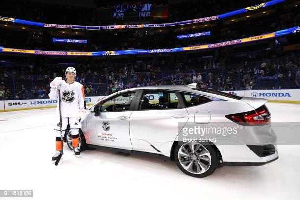 Brock Boeser of the Vancouver Canucks stands by his new Electric Honda after winning the MVP during the 2018 Honda NHL AllStar Game between the...