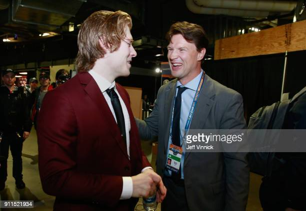 Brock Boeser of the Vancouver Canucks talks former NHL player Shane Doan after the 2018 Honda NHL AllStar Game at Amalie Arena on January 28 2018 in...