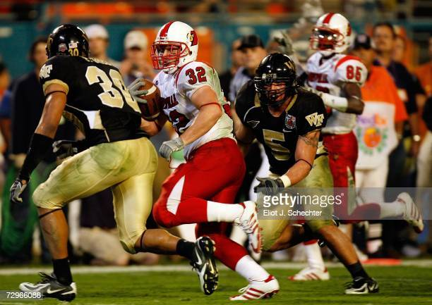 Brock Bolen of the Louisville Cardinals runs with the ball in the fourth quarter against the Wake Forest Demon Deacons during the 2007 FedEx Orange...