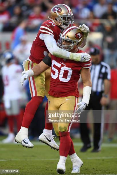 Brock Coyle and Reuben Foster of the San Francisco 49ers react after a play against the New York Giants during their NFL game at Levi's Stadium on...