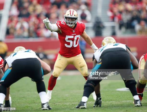 Brock Coyle of the San Francisco 49ers calls defensive signs during the game against the Jacksonville Jaguars at Levi's Stadium on December 24, 2017...