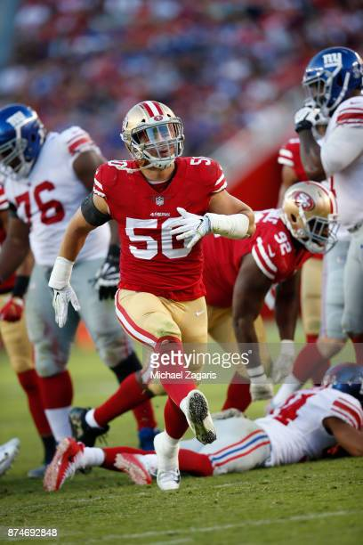 Brock Coyle of the San Francisco 49ers celebrates after making a defensive stop during the game against the New York Giants at Levi's Stadium on...