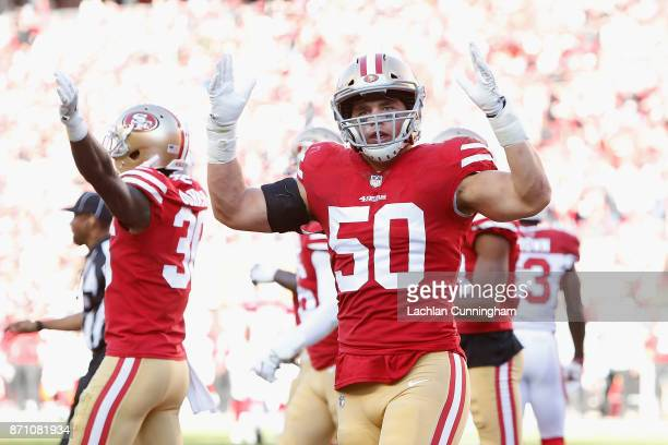 Brock Coyle of the San Francisco 49ers celebrates after teammate Eric Reid made an interception against the Arizona Cardinals at Levi's Stadium on...